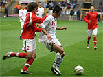 Action Photograph of England and Welsh players tackling for the ball at Molinuex