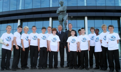 FA Chairman David Bernstein with John Scales and pupils from Cardinal Heenan School and Lancaster School